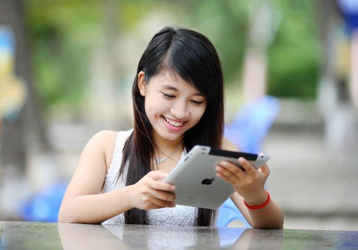Student holding iPad